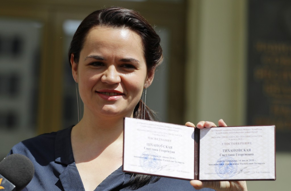 Svetlana Tikhanovskaya shows her presidential candidate's identification card after she was registered as a candidate for the presidential elections i...