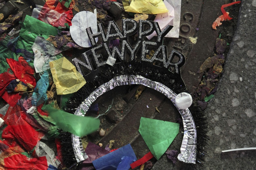 FILE - In this Jan. 1, 2020, file photo, cand other debris lies on the street in New York's Times Square, early New Year's Day. 2020 is barely halfway...