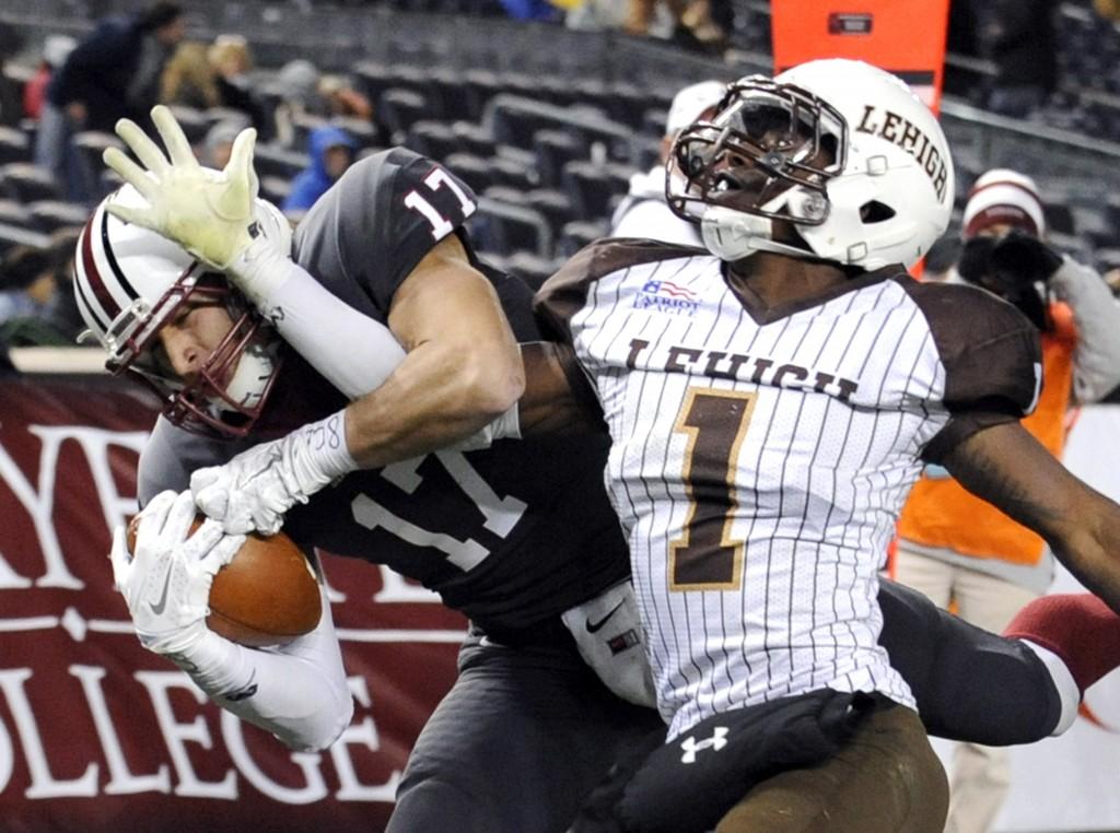 FILE - In this Nov. 22, 2014, file photo, Lafayette wide receiver Matt Mrazek, left, catches a touchdown pass as Lehigh cornerback Oliver Riguad defen...