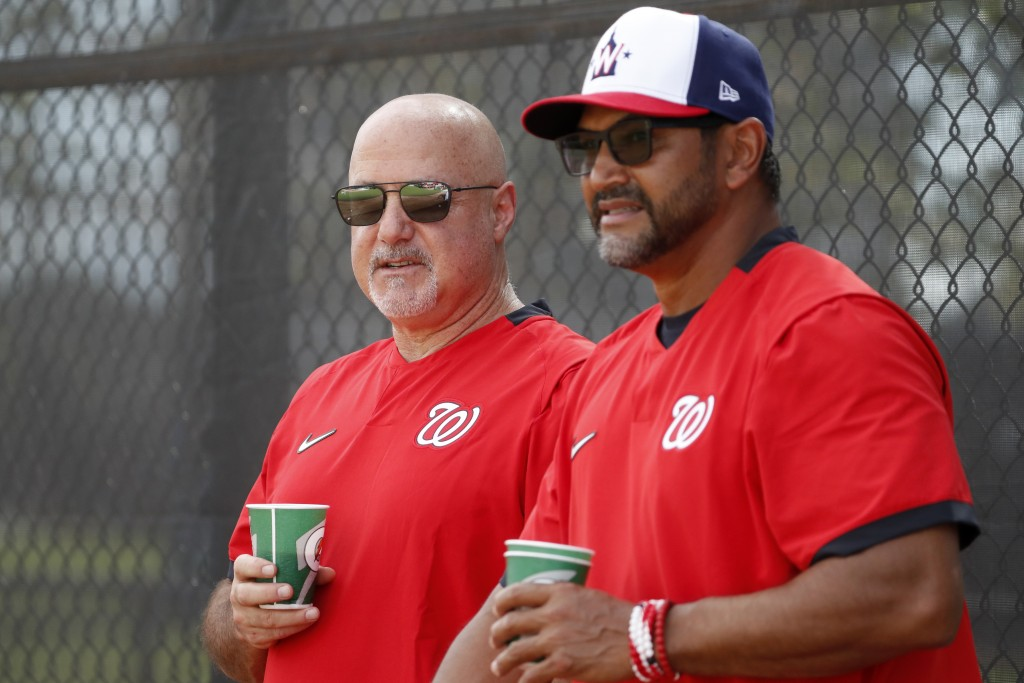 FILE - In this Feb. 17, 2020, file photo, Washington Nationals general manager Mike Rizzo, left, talks with manager Dave Martinez during spring traini...