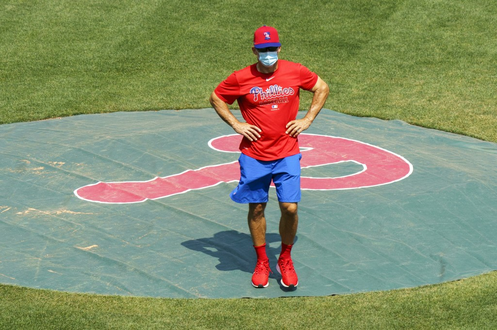 FILE - In this July 3, 2020, file photo, Philadelphia Phillies manager Joe Girardi looks on from the pitchers mound during a baseball training session...