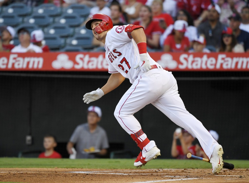 FILE - In this July 27, 2019, file photo, Los Angeles Angels' Mike Trout runs to first while watching his two-run home run during the first inning of ...