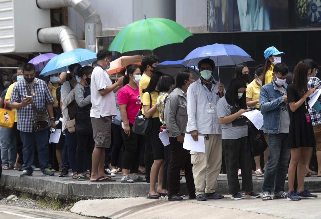 People line up for the coronavirus test in Rayong province, Thailand, Tuesday, July 14, 2020. Authorities set up testing for anyone concerned they mig...