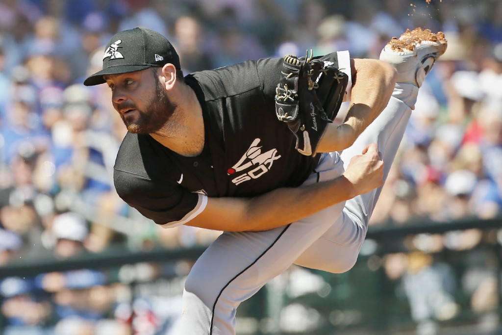FILE - In this March 6, 2020, file photo, Chicago White Sox starter Lucas Giolito pitches in the first inning of a spring training baseball game again...