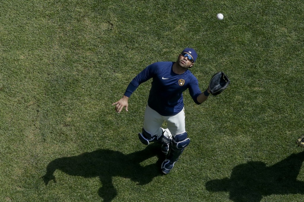 Milwaukee Brewers' Manny Pina catches a ball during a practice session Monday, July 13, 2020, at Miller Park in Milwaukee. (AP Photo/Morry Gash)