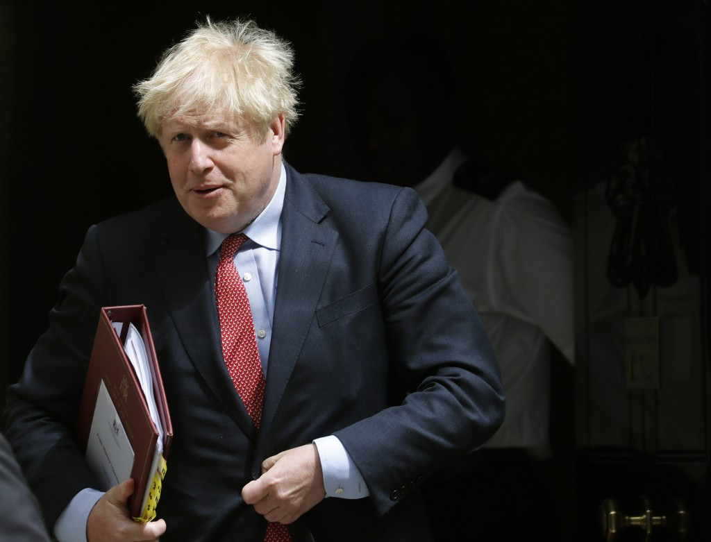 Britain's Prime Boris Johnson leaves 10 Downing Street to attend the weekly Prime Minister's Questions session, in parliament in London, Wednesday, Ju...