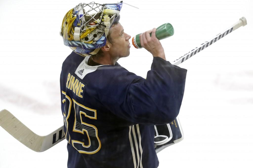 Nashville Predators goaltender Pekka Rinne, of Finland, takes a drink during NHL hockey training camp Tuesday, July 14, 2020, in Nashville, Tenn. (AP ...