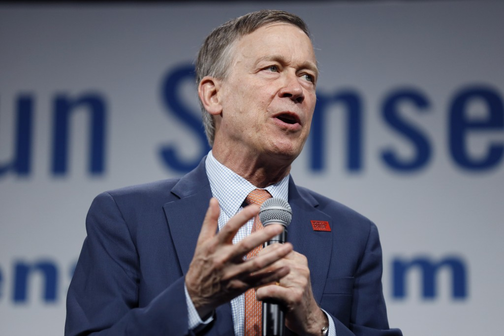 FILE - In this Aug. 10, 2019, file photo, then Democratic presidential candidate former Colorado Gov. John Hickenlooper speaks in Des Moines, Iowa.   ...