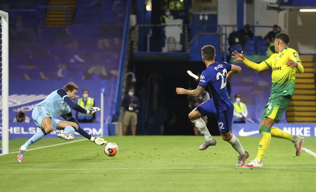 Norwich City's goalkeeper Tim Krul, left, saves a shot from Chelsea's Christian Pulisic, centre, during the English Premier League soccer match betwee...