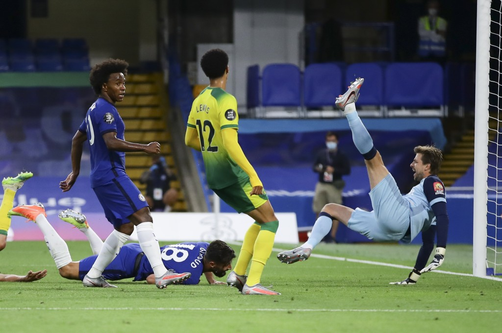 Chelsea's Olivier Giroud, on ground, scores his team's first goal during the English Premier League soccer match between Chelsea and Norwich City at S...