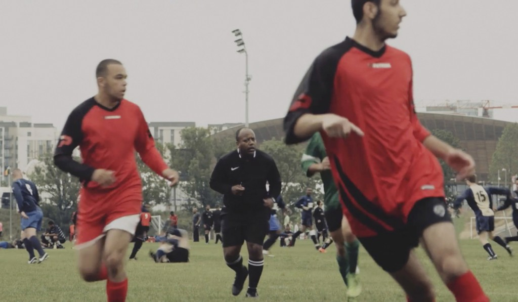 This grab taken from video taken on Aug. 23, 2015, shows  Jermaine Wright, centre, a NHS pharmacist and a referee of the Hackney Marshes grassroots fo...