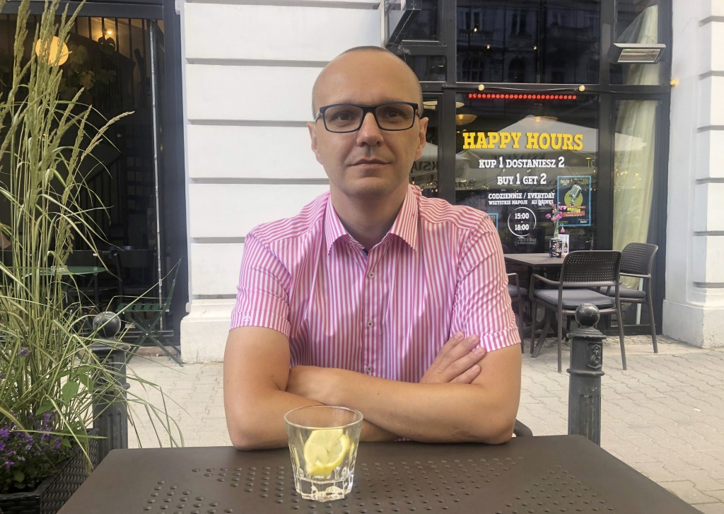 Mariusz Kurc, the editor of Poland's only LGBT magazine, Replika, sits during an interview in Warsaw, Poland, July 14, 2020. Members of Poland's LGBT ...