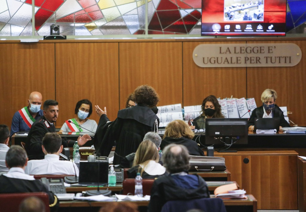 Italian Carabinieri paramilitary police officer Andrea Varriale, left, listens to prosecutor Maria Sabina Calabretta's questions during the trial for ...