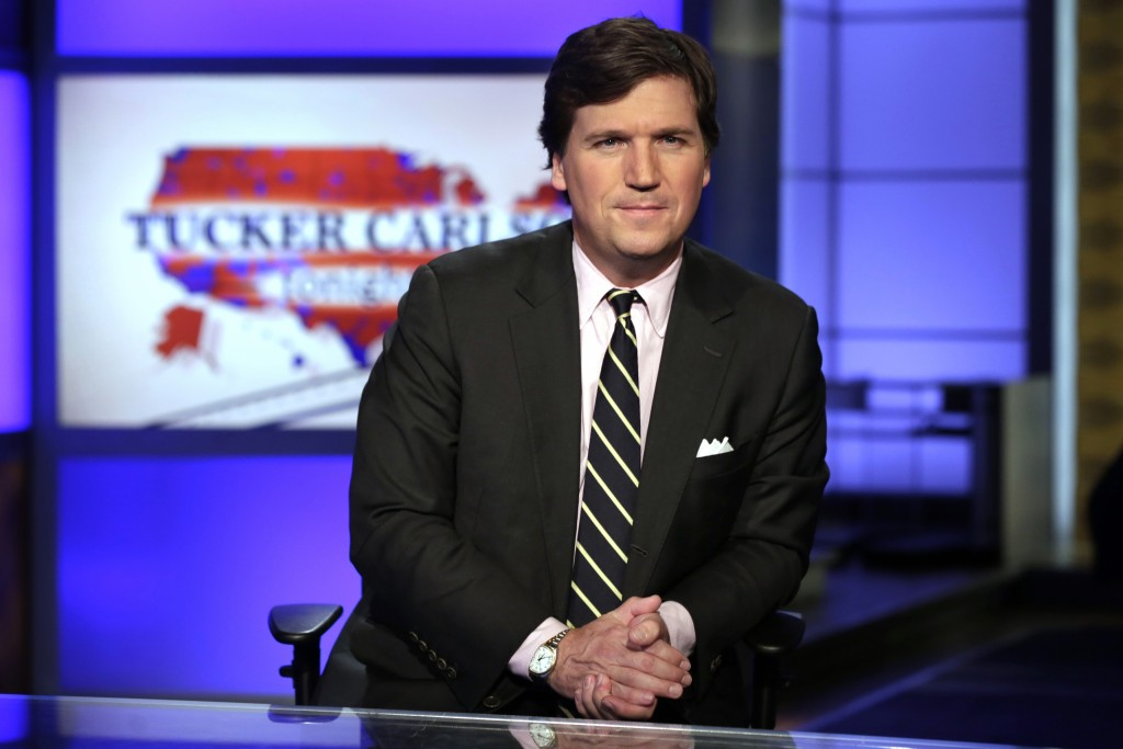 "FILE - In this March 2, 2017 file photo, Tucker Carlson, host of ""Tucker Carlson Tonight,"" poses for photos in a Fox News Channel studio, in New York...."