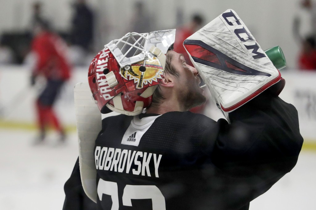 Florida Panthers goaltender Sergei Bobrovsky takes a drink during NHL hockey training camp, Tuesday, July 14, 2020, in Coral Springs, Fla. (AP Photo/L...