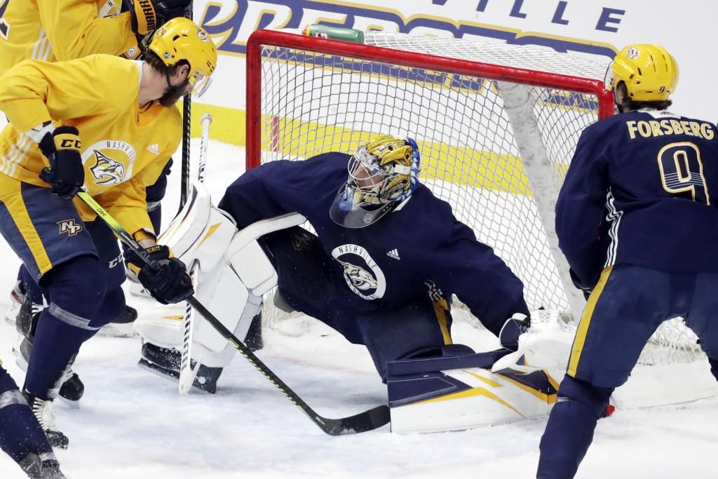 Nashville Predators goaltender Pekka Rinne, of Finland, of Finland, blocks a shot during NHL hockey training camp Tuesday, July 14, 2020, in Nashville...