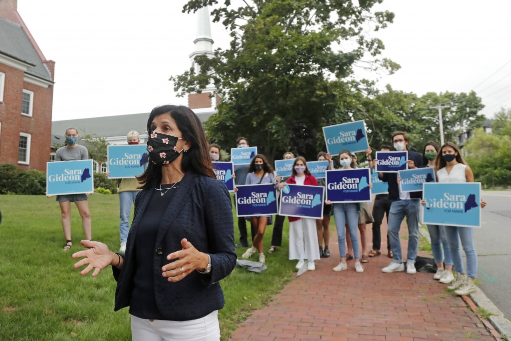 House speaker Sara Gideon, D-Freeport, speaks to the media near a polling station, Tuesday, July 14, 2020, in Portland, Maine. Gideon is one of three ...
