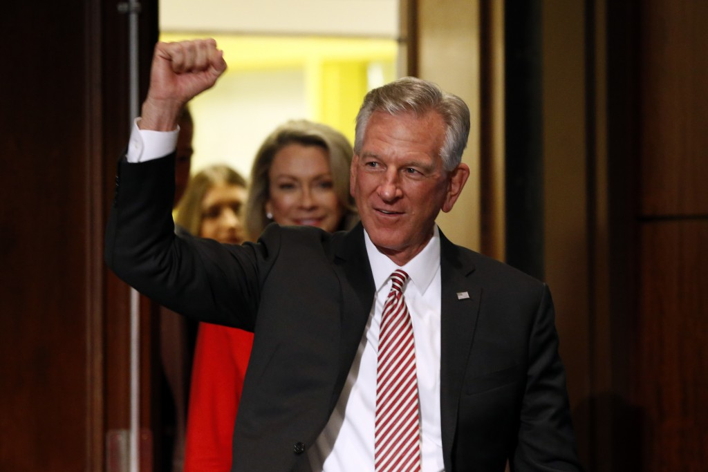 Former Auburn football coach Tommy Tuberville gestures while greeting supporters after he defeated Jeff Sessions in the Republican primary for U.S. Se...