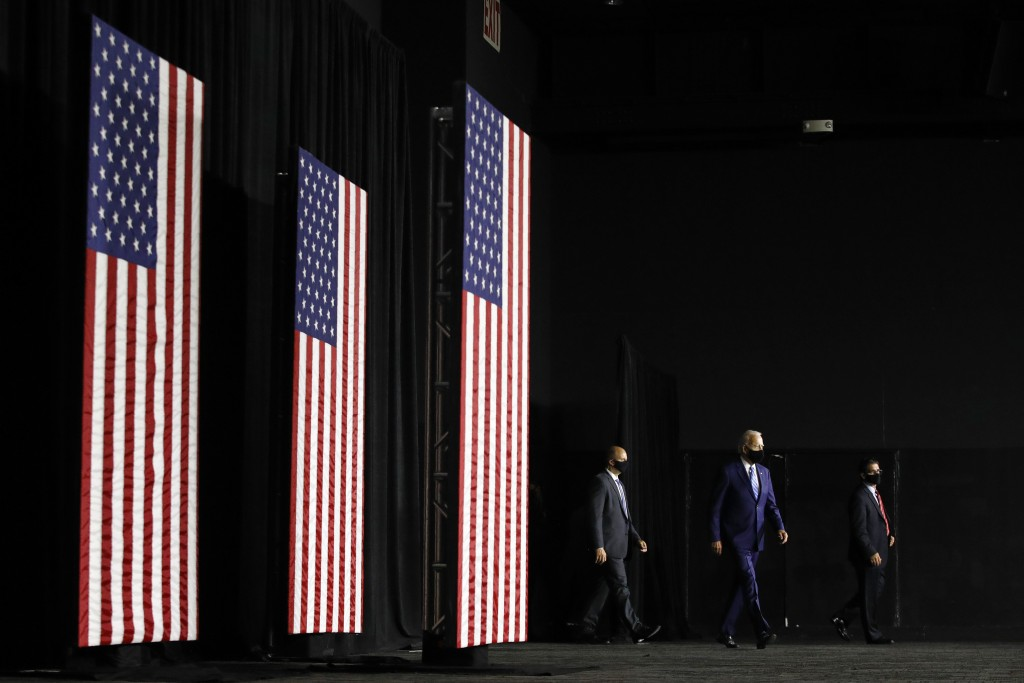 Democratic presidential candidate, former Vice President Joe Biden, second from right, arrives to speak at a campaign event, Tuesday, July 14, 2020, i...