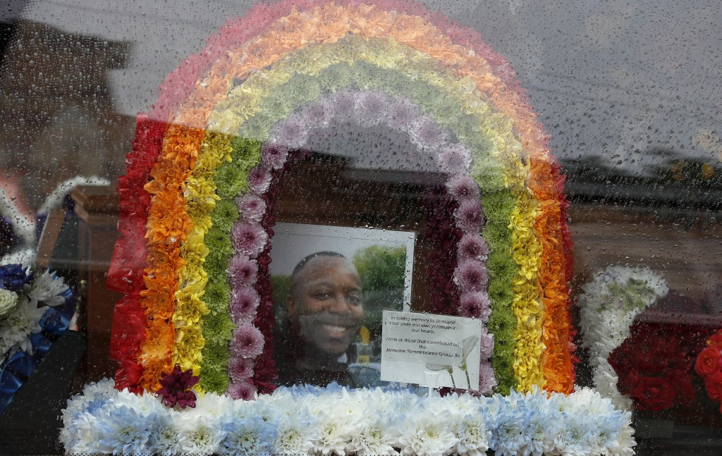 In this photo taken on Thursday, June 11, 2020, a view of photo and floral tribute for Jermaine Wright, a pharmacist and a referee of the Hackney Mars...