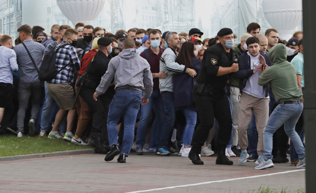 Police officers detain protesters during a rally against the removal of opposition candidates from the presidential elections in Minsk, Belarus, Tuesd...