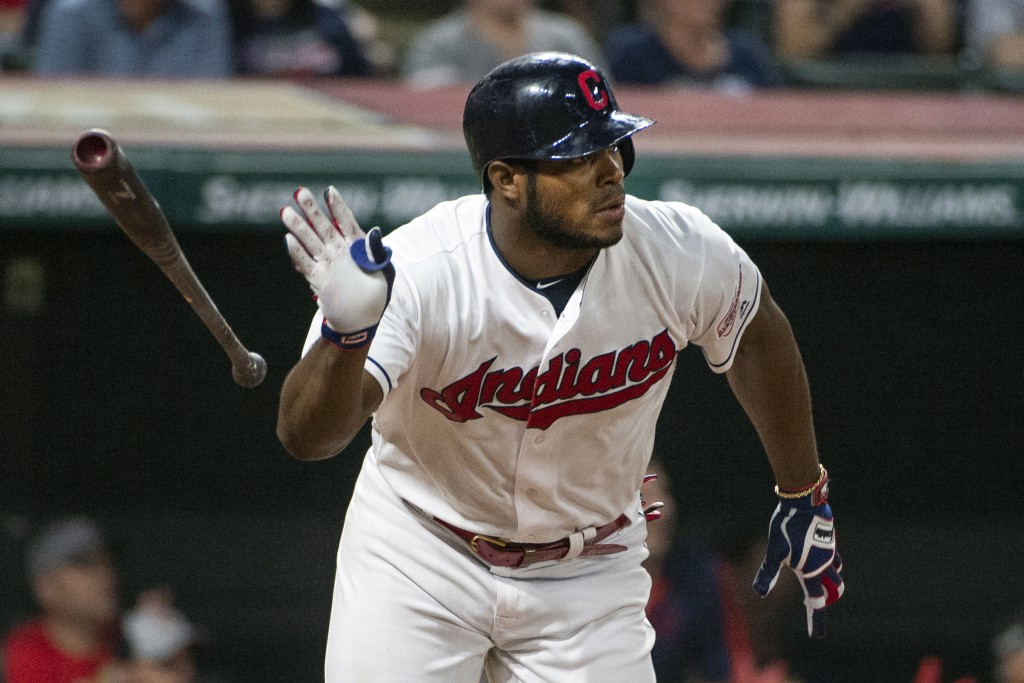 FILE - In this Sept. 22, 2019, file photo, Cleveland Indians' Yasiel Puig watches his three-run double off of Philadelphia Phillies relief pitcher Col...