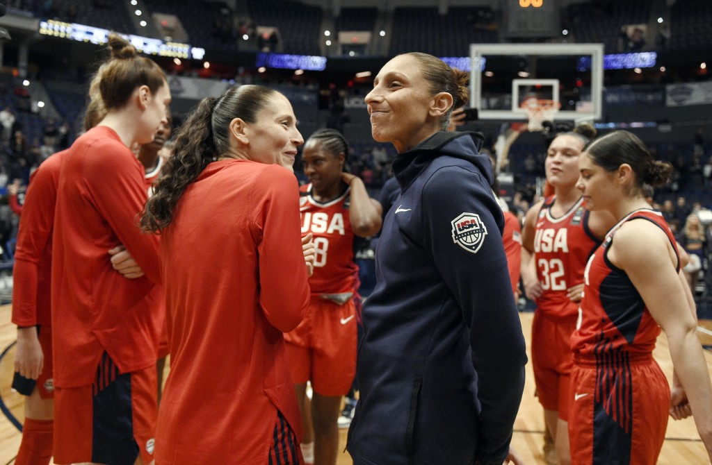 FILE - In this Jan. 27, 2020, file photo, United States' Sue Bird, left, and Diana Taurasi share a light moment at the end of an exhibition basketball...