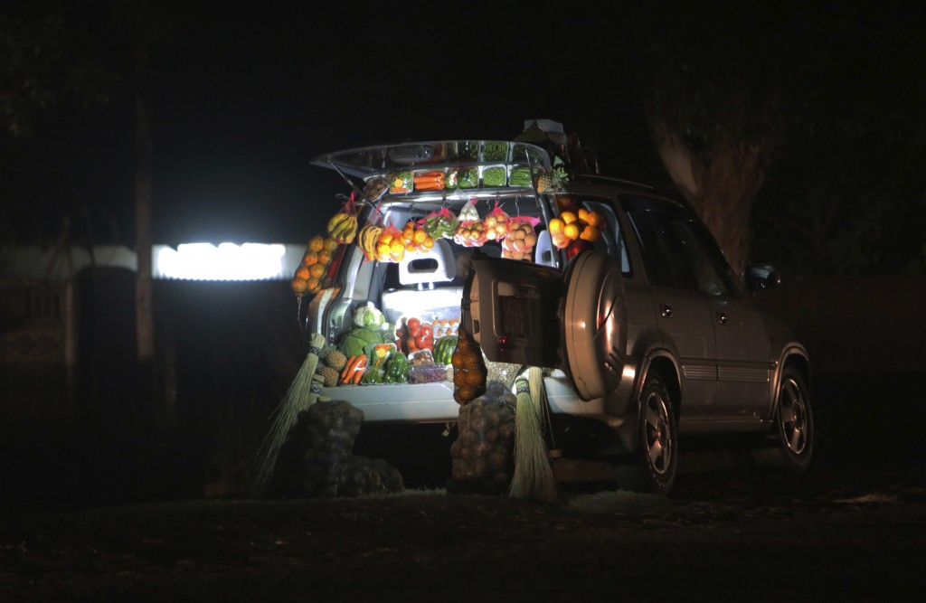 A car displays fruits and vegetables while selling them by the side of a busy road in Harare, Zimbabwe, Tuesday, June 23, 2020. Cars have become mobil...