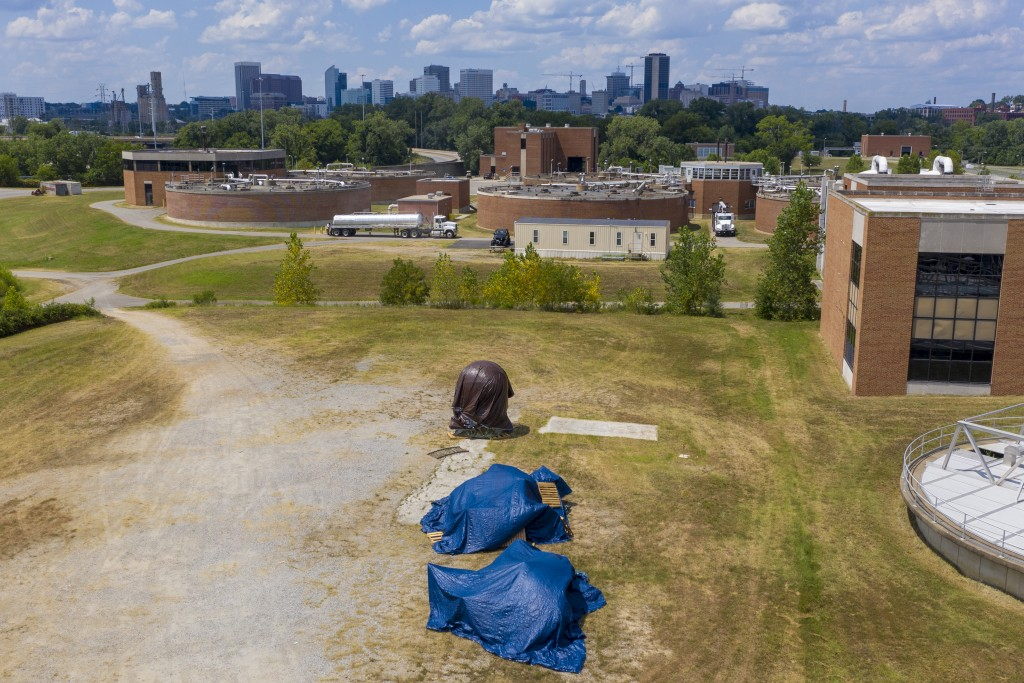 Confederate statues are covered in tarps while being stored at a waste water treatment plant near downtown Tuesday July 14, 2020, in Richmond, Va. The...