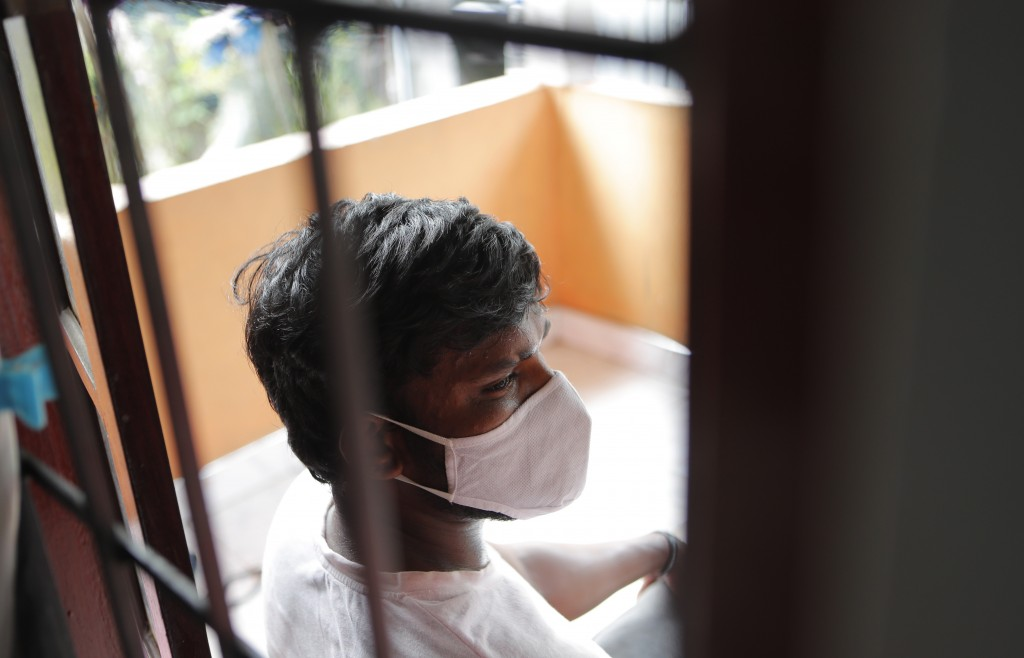 Sri Lankan auto rickshaw driver Prasad Dinesh, linked by Sri Lankan officials to nearly half the country's more than 2,600 coronavirus cases, sits in ...