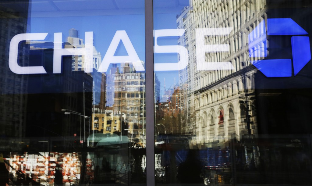 FILE- This Jan. 11, 2016, file photo shows a Chase bank branch in New York.  The coronavirus pandemic is weighing heavily on the financial health of J...
