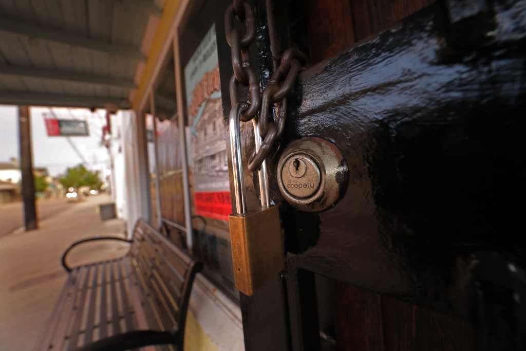 A padlock hangs on the door of the Maple Leaf Bar on Oak Street in New Orleans, Tuesday, July 14, 2020. Many bars are closed after after Gov. John Bel...
