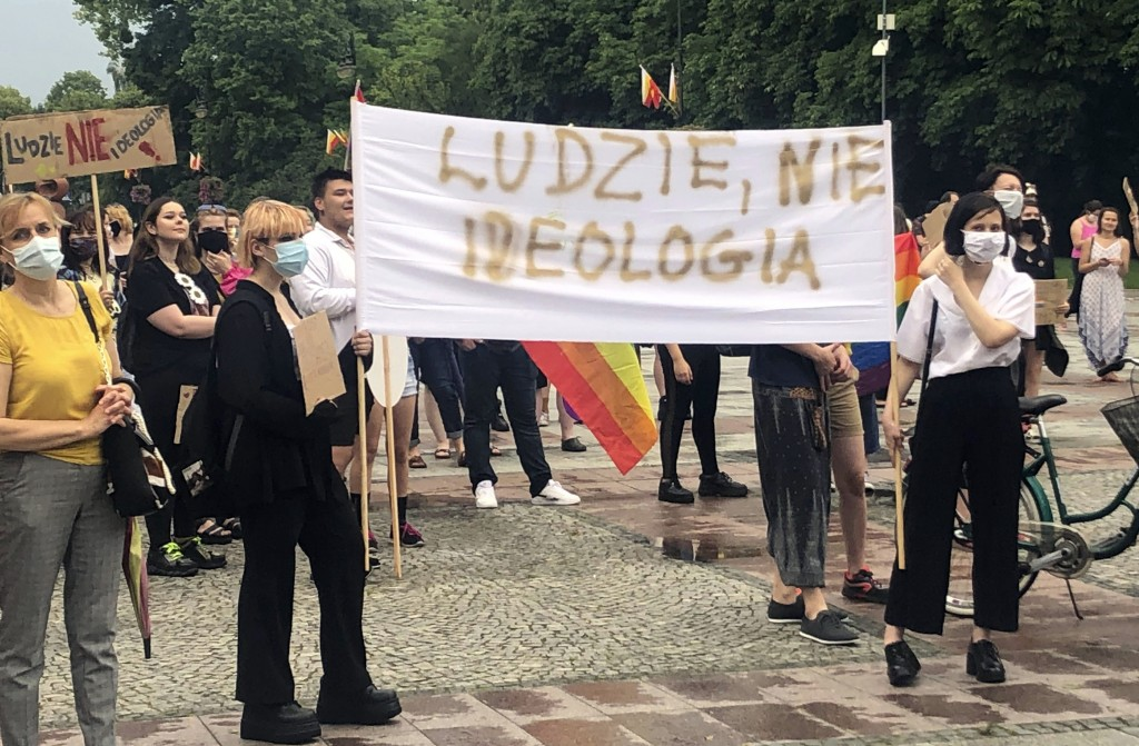"""Protesters hold a sign saying """"People, not Ideology,"""" at a protest of the homophobic rhetoric of Polish President Andrzej Duda in Bialystok, Poland, o..."""
