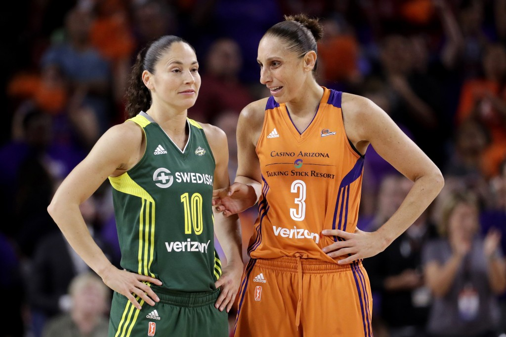 FILE - In this Sept. 6, 2017 file photo, Phoenix Mercury guard Diana Taurasi (3) talks with Seattle Storm guard Sue Bird (10) during the second half o...