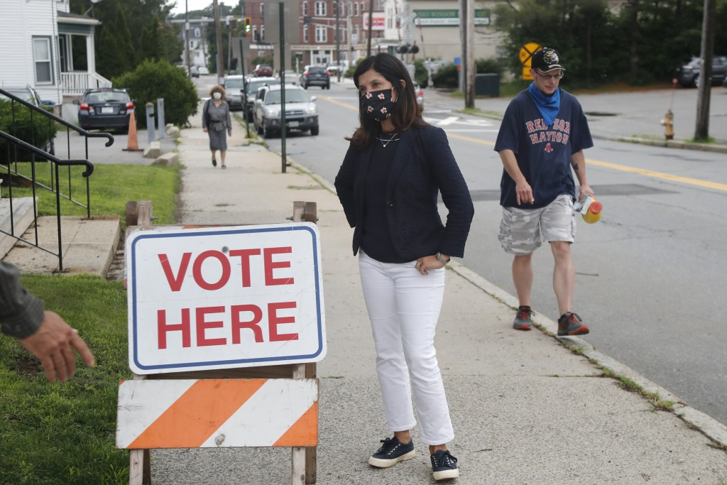 House Speaker Sara Gideon, D-Freeport, speaks to people near a polling station, Tuesday, July 14, 2020, in Portland, Maine. Gideon is one of three Dem...
