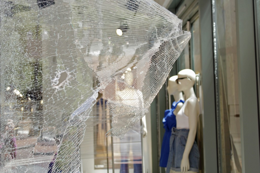 Mannequins are seen through shattered glass at an H&M store in downtown Portland, Ore., Monday, July 13, 2020, after protests the night before. While ...