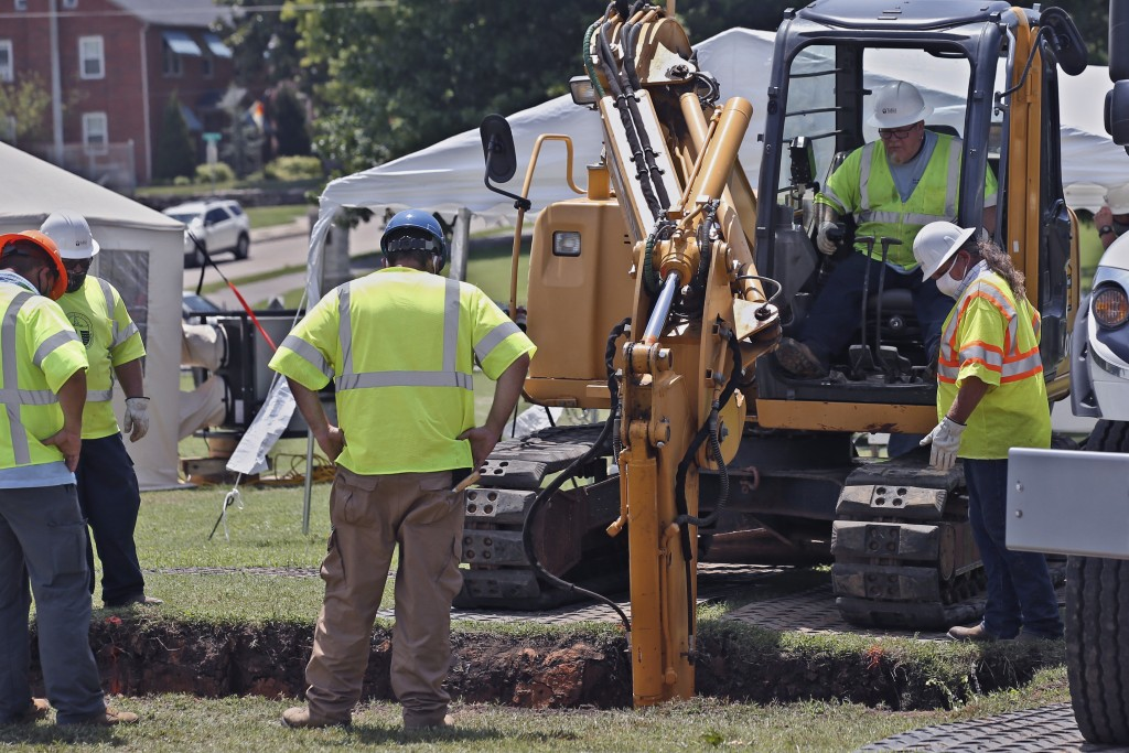 A backhoe digs deeper into the excavation site as work continues on an excavation of a potential unmarked mass grave from the 1921 Tulsa Race Massacre...