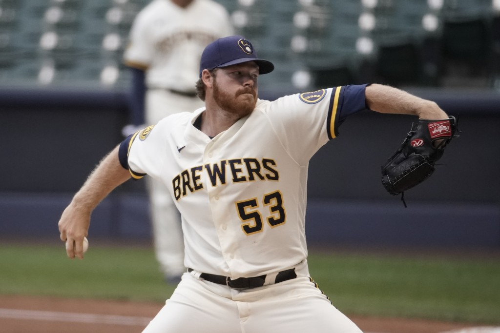 Milwaukee Brewers' Brandon Woodruff throws during an intrasquad game Tuesday, July 14, 2020, at Miller Park in Milwaukee. (AP Photo/Morry Gash)