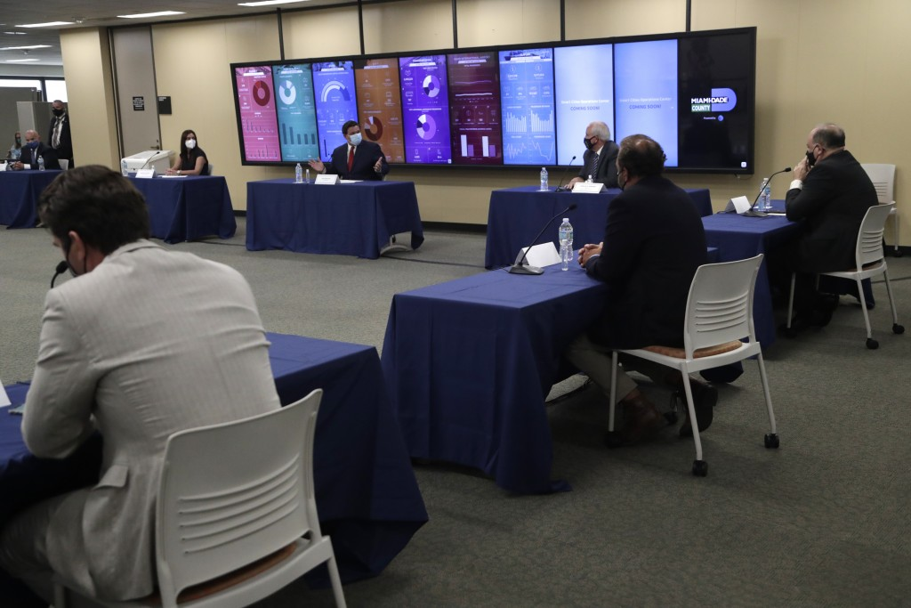 Florida Gov. Ron DeSantis, center, speaks during a roundtable discussion with Miami-Dade County mayors during the coronavirus pandemic, Tuesday, July ...