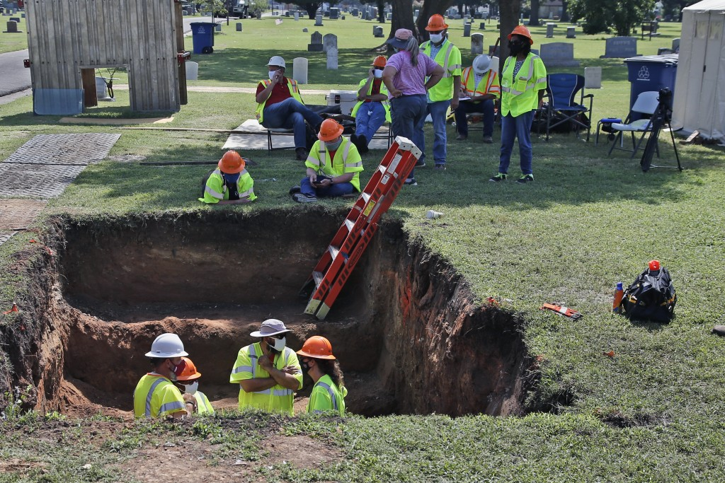 Work continues on an excavation of a potential unmarked mass grave from the 1921 Tulsa Race Massacre, at Oaklawn Cemetery in Tulsa, Okla., Tuesday, Ju...