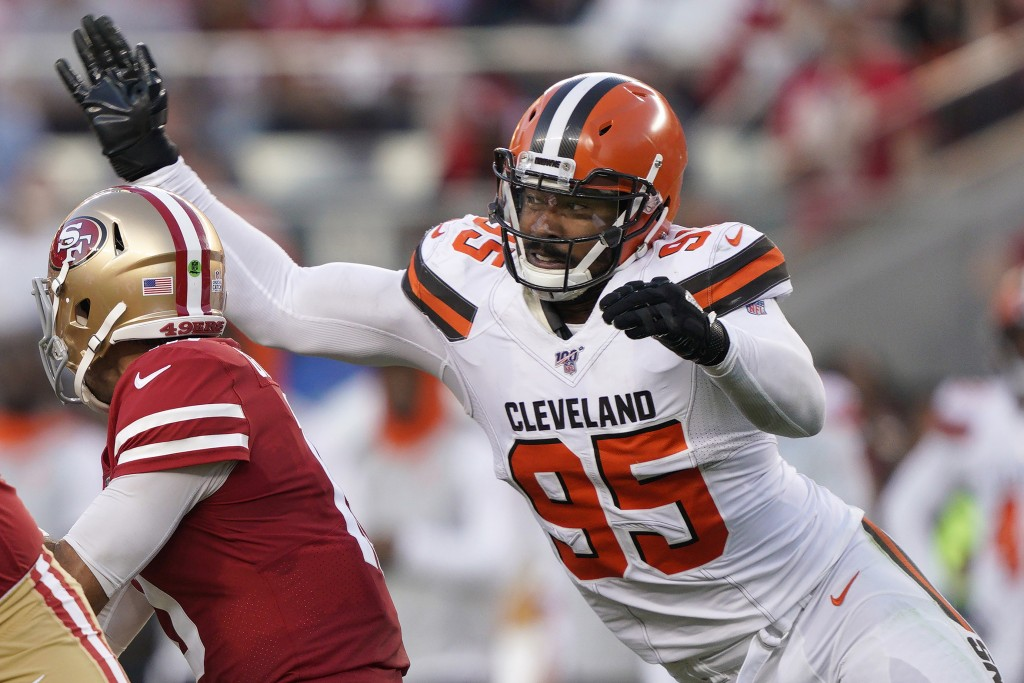 FILE - In this Oct. 7, 2019, file photo, Cleveland Browns defensive end Myles Garrett (95) sacks San Francisco 49ers quarterback Jimmy Garoppolo durin...