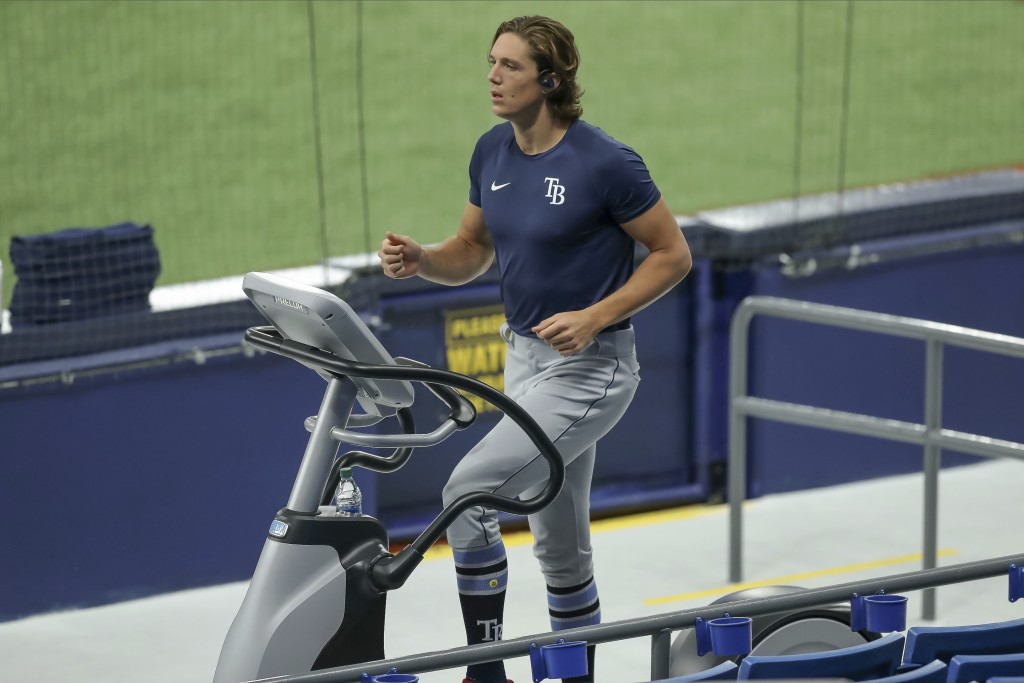 Tampa Bay Rays' Tyler Glasnow warms up during baseball practice, Tuesday, July 14, 2020, in St. Petersburg, Fla. (AP Photo/Mike Carlson)