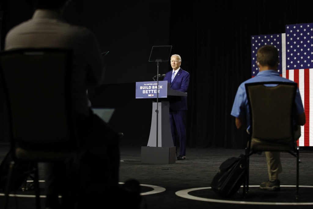 Democratic presidential candidate, former Vice President Joe Biden speaks as reporters sit socially distant during a campaign event, Tuesday, July 14,...