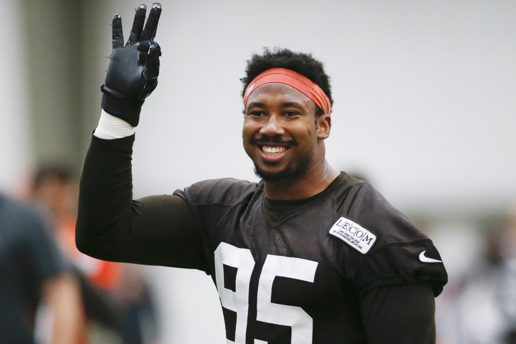 FILE - In this June 6, 2019, file photo, Cleveland Browns defensive end Myles Garrett reacts after a play during practice at the team's NFL football t...