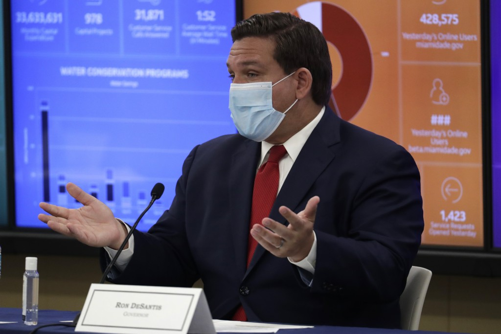 Florida Gov. Ron DeSantis speaks during a roundtable discussion with Miami-Dade County mayors during the coronavirus pandemic, Tuesday, July 14, 2020,...