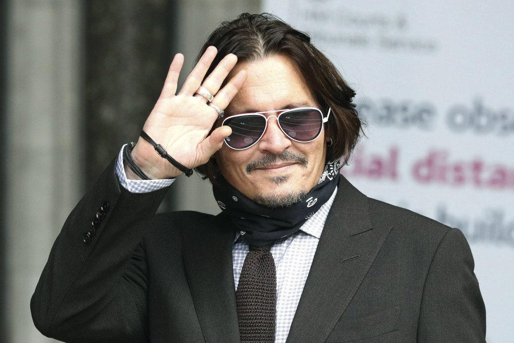 Actor Johnny Depp arrives at the High Court to give evidence in his libel case, in London, Wednesday July 15, 2020. Depp is suing News Group Newspaper...