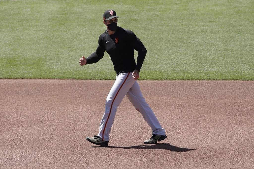 San Francisco Giants manager Gabe Kapler walks on the field during baseball practice in San Francisco, Tuesday, July 14, 2020. (AP Photo/Jeff Chiu)