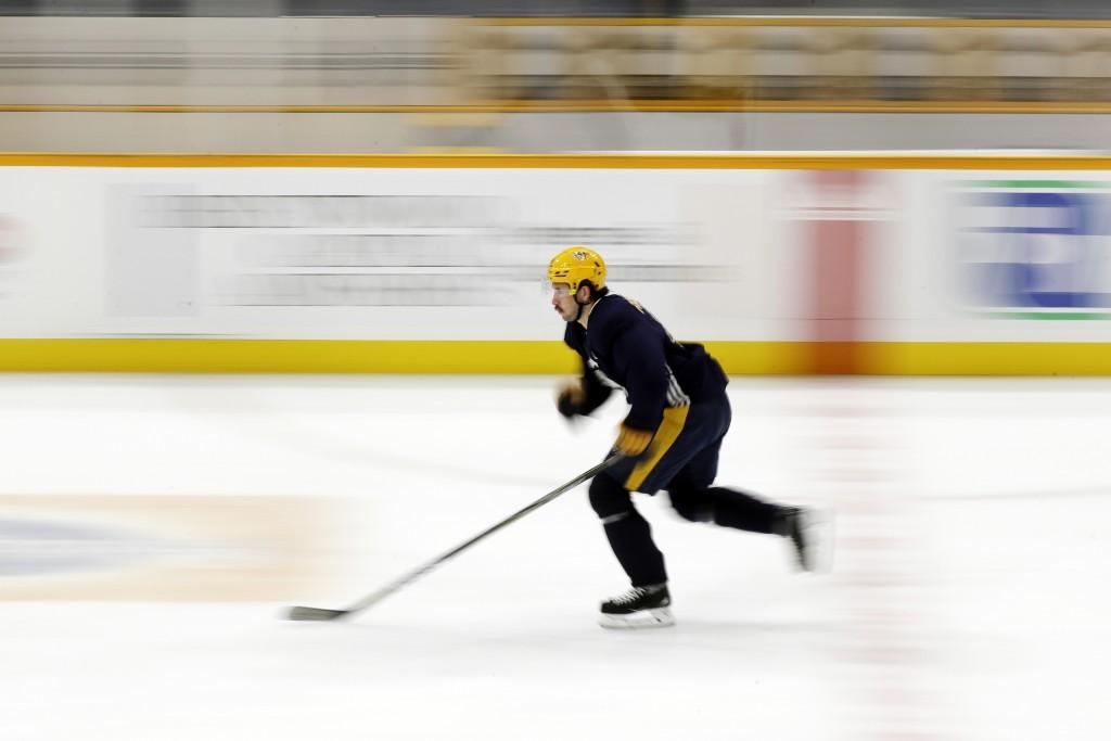 In this image taken with a slow shutter speed, Nashville Predators left wing Filip Forsberg, of Sweden, skates during NHL hockey training camp, Tuesda...
