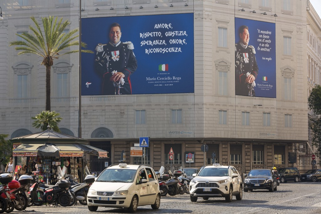 Posters portraying the Italian Carabinieri paramilitary police officer Mario Cerciello Rega, are displayed in the square where he was stabbed to death...