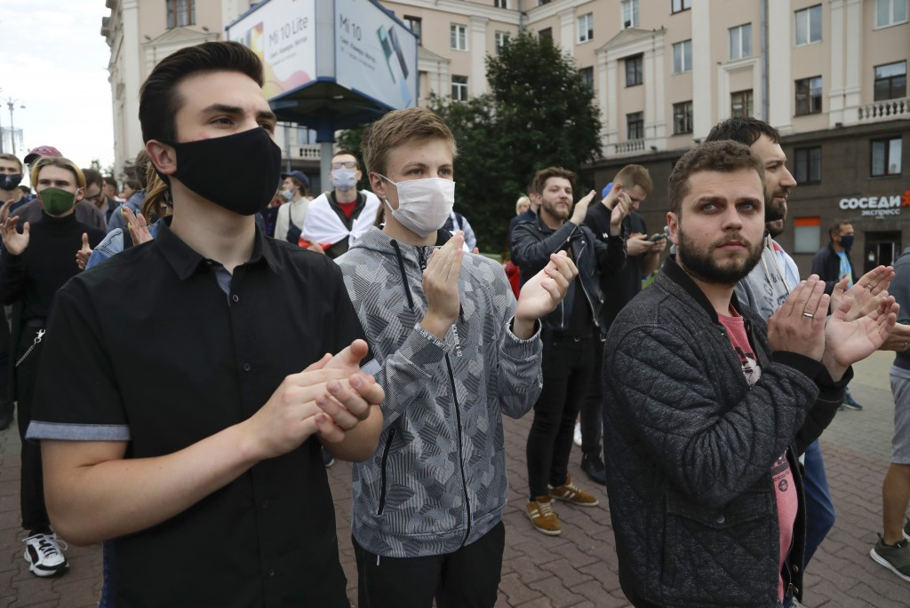 People applaud during a protest rally against the removal of opposition candidates from the presidential elections in Minsk, Belarus, Tuesday July 14,...